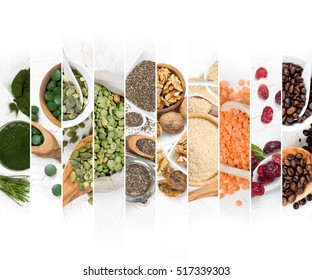 Top view of mixed colorful chlorella, berries, nuts and seeds scattered on white wooden surface; dieting and detoxication concept