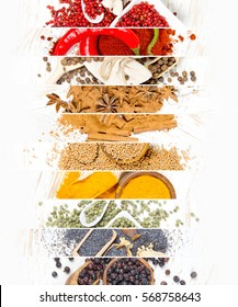 Top view of mixed colorful spice scattered on white wooden surface; white space for text