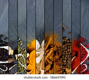 Top view of mixed colorful spice scattered on gray slate tile surface
