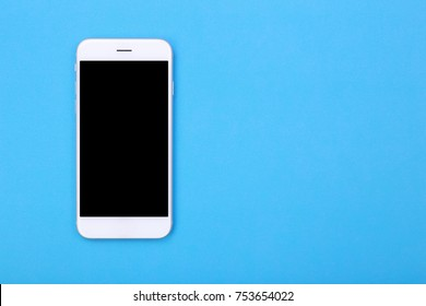 Top view mockup smartphone on blue pastel background