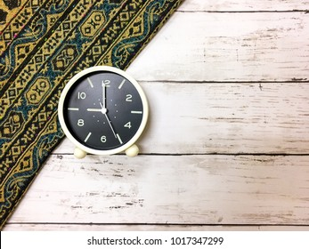 Top View, Modern Alarm Clock over the wooden background
