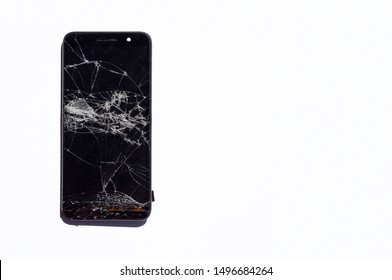 Top view Modern broken mobile phone isolated on white background. Cracked glass on a screen. Copy space for text. Smartphones repair concept