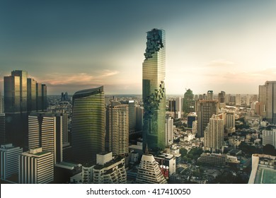 Top view : modern building in Business district at Bangkok city with skyline at twilight,Thailand.