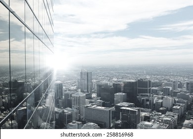 Top view of modern city in lights of sunset