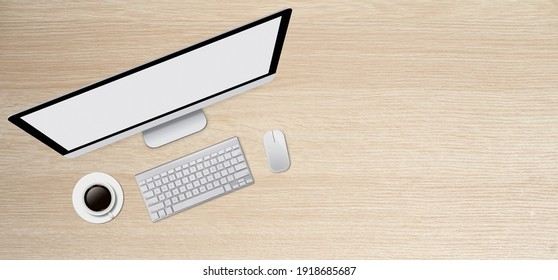 Top View Modern Computer Set on a wooden desk with coffee cup