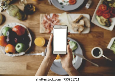 Top view of modern smartphone with a blank screen with space for your design or text message, mock-up of mobile phone, food order online concept
