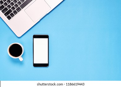 Top view, Modern workplace with laptop and smartphone, coffee. placed on a pastel background. Copy space suitable for use in graphics.