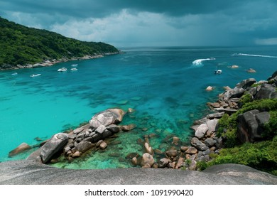 Top view from the mountain on tropical island, sea with boats and cloudy sky