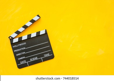 Top view of movie clapper board isolated on yellow