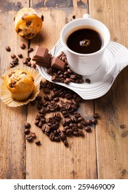 top view of muffins with coffee on wooden table