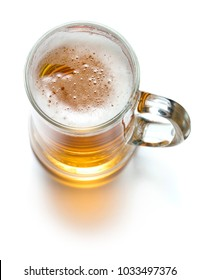 top view of mug of beer with foam isolated on white background