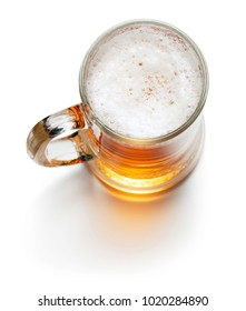 top view of mug of beer isolated on white background