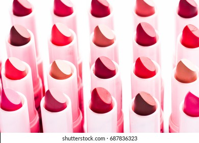 top view multicolored color lipsticks place a square isolated on white shallow depth of field.