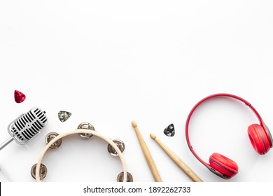 Top view of musical instrument with eadphones, flat design background