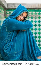 top view of a muslim woman in traditional dress with her head covered . concept of submission in women