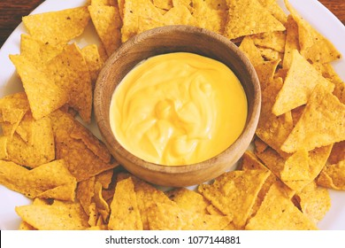 Top view of nachos with cheese dip. Unhealthy food concept