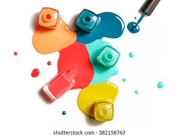 Top view of nail polish splatter on white background