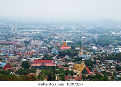 Top view of Nakhon Sawan city with big gold Buddha statue, Thailand