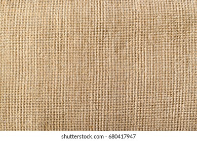 Top view of natural brown hessian cloth or gunny sack. Hessian cloth is an inexpensive fabric or garment made of hessian or burlap formed of jute, coarsely woven fabric. Abstract texture background