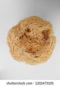 Top view of natural sponge loofah (sponge gourd, luffa) isolated on white background. Taiwanese traditional daily necessities, often used to wash dishes, clean and bathe.