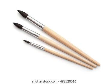 Top view of new  artistic paint brushes set isolated on white