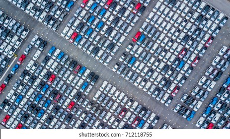 Top view of new cars lined up outside an automobile factory for import & Export.
