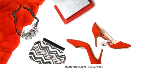 Top view to New Year and Christmas outfit layout: red shoes, accessories jewelry, clutch, gift box on white background, isolated. Party Valentine's Day, wedding concept. Flat lay, copy space. Banner.