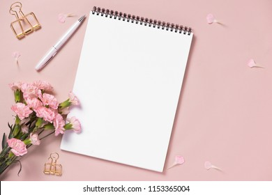 Top view note book anf flowers on the desktop. For wedding planner concept