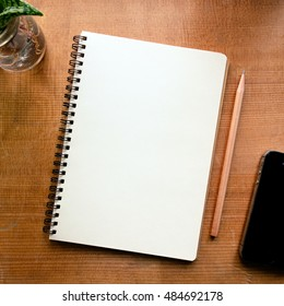 Top view of notebook on wood background