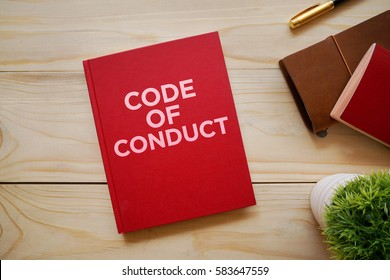 Top view of notebook with word Code of Conduct