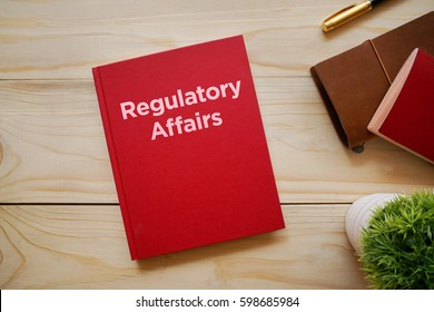 Top view of notebook with word Regulatory Affairs