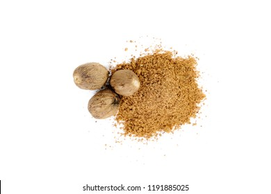 Top view of nutmeg seed and ground nutmeg on white background, isolated. Nutmeg. The concept of seasoning dishes, using spices and herbs for meals.