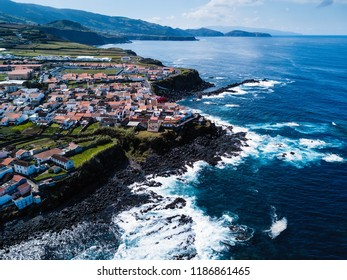 Top view of the ocean surf on the reefs coast of San Miguel island, Azores, Portugal.