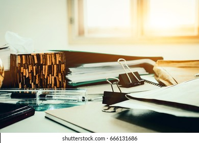 Top view of office desk with paper, stationery and tablet computer. Concept of Many documents on office desk. stack of folders and documents.