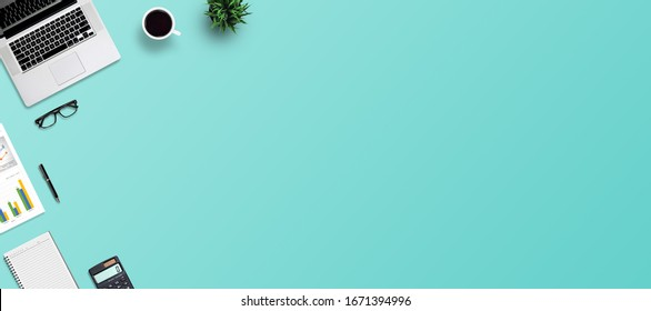 Top view office desk and supplies, with copy space. Creative flat lay photo of workspace desk/Panoramic banner and isolated on blue background