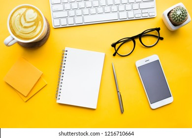 Top view of office desk table with modern accessories,supplies on color background.flat lay design.business concepts ideas
