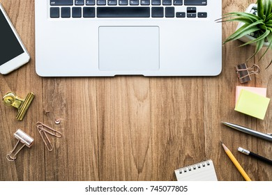 Top view of office desk table with modern laptop and accessories objects on wooden.Business,education concepts ideas/flat lay design