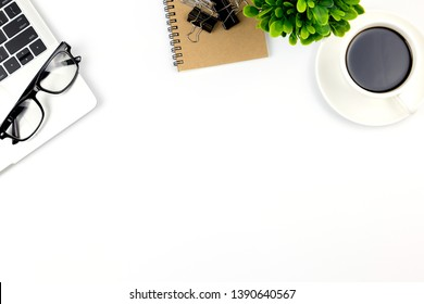 Top view of Office desk with workspace in office with blank notebook and other office supplies,with copy space.