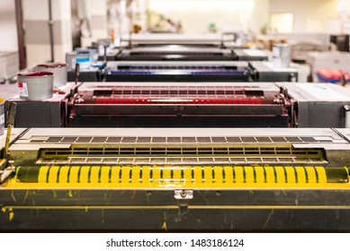 top view of an offset sheetfed printing maschine in a printing facility