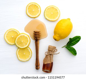 Top view of,honey and lemon on white background in concept benefits of honey and lemon.Natural skin care,great drink recipe,chest congestion remedy.easiest way to get rid of soar throat and coughing.