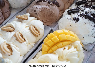 Top view ofice cream with cookie,chocolate and Mango in Freezer.