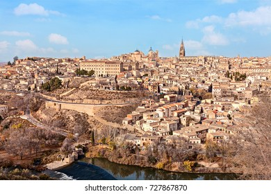 Top view of old medieval Toledo from hill in winter sunny day. Spain.