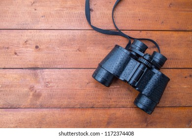 Top view of a old pair of binoculars on a table
