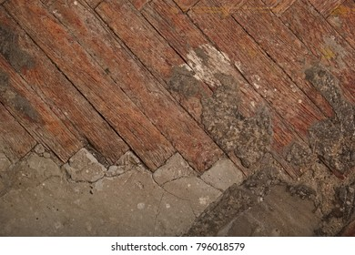Top view of old parquet and concrete floor under it
