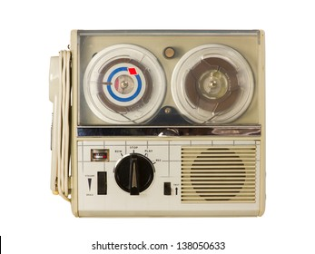 Top view of an old portable reel-to-reel mini tape-recorder with microphone, isolated over white background with clipping path.