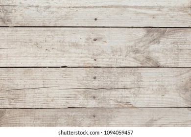 Top view of old rough wooden background with clogged nails.