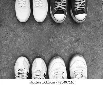 Top view of old sneaker shoes on floor background with black and white style