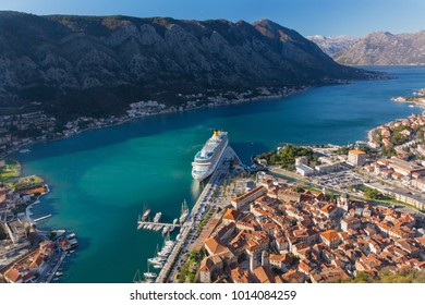 Top view of the old town in Kotor and a big cruise ship, Montenegro