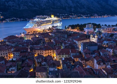 Top view of the old town in Kotor and a big cruise ship at night, Montenegro