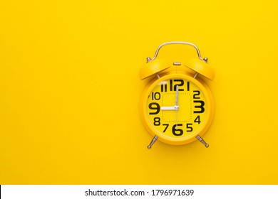 Top view old yellow alarm clock on bright color background - Shutterstock ID 1796971639